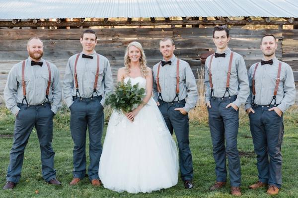 Bride with groomsmen in bow ties