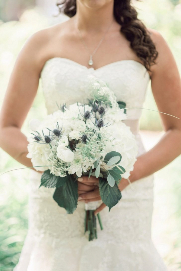 Bridal bouquet of hydrangea, thistle, and tulip