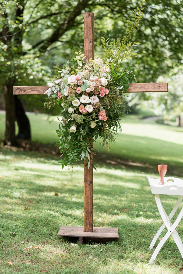 Ceremony cross decorated in florals