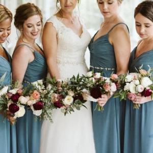Bridesmaids in long teal dresses
