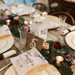 Lantern centerpieces at farm table reception