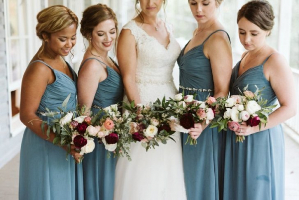 Bridesmaids in long teal dresses