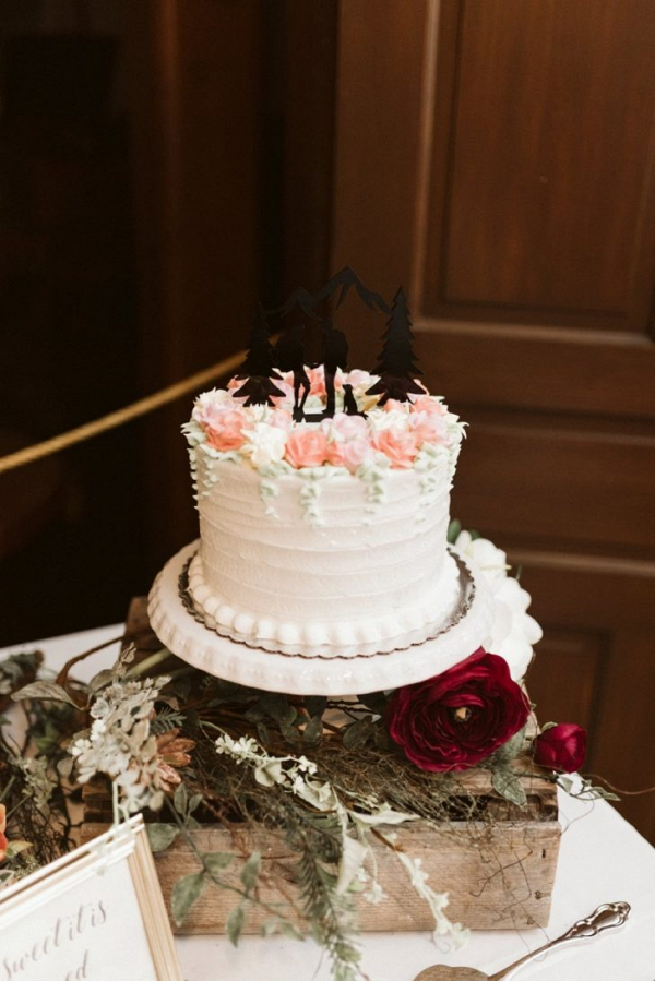 Small wedding cake with silhouette topper
