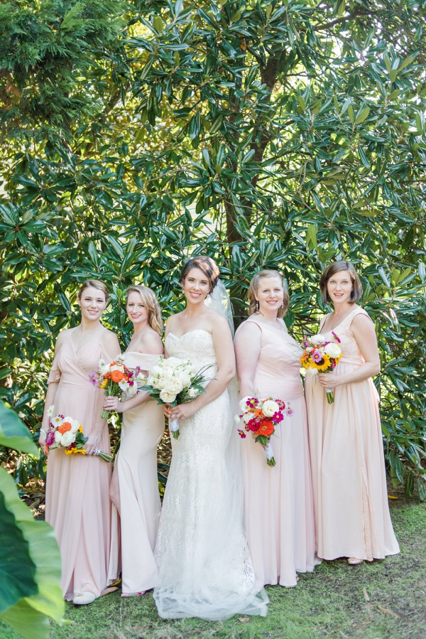 Bridesmaids in mismatched blush and cream dresses