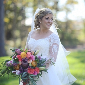 bride in long sleeve wedding gown on The Budget Savvy Bride
