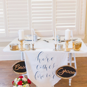 Sweetheart table with calligraphy signage