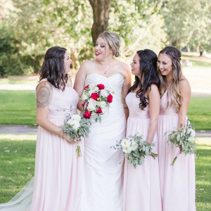 Bride with red lip with blush bridesmaids