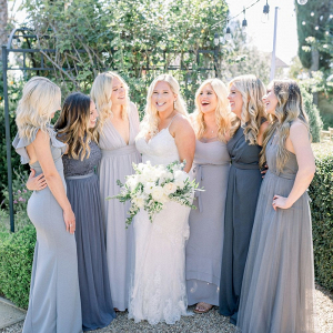 9e82ef3c7f White bridal bouquet  Bridesmaids in mismatched gray dresses ...