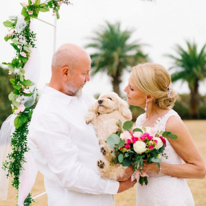 Beach wedding ceremony with dog