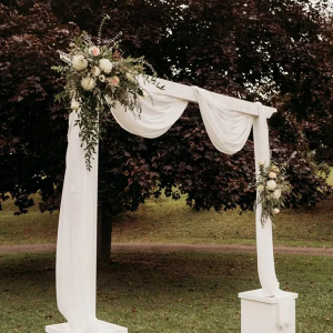 Draped wedding ceremony arch