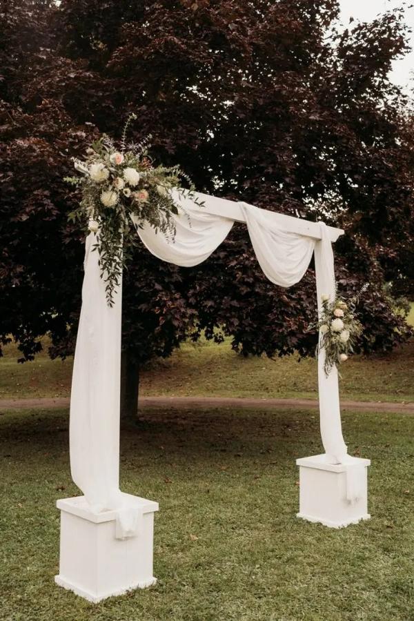 Draped wedding ceremony arch