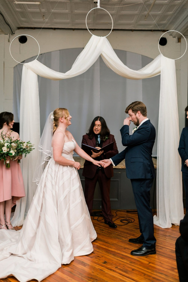 Hoop and drapery ceremony backdrop