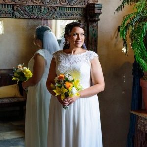 Bride with orange and yellow bouquet