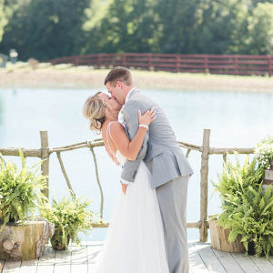 First kiss at lakeside ceremony