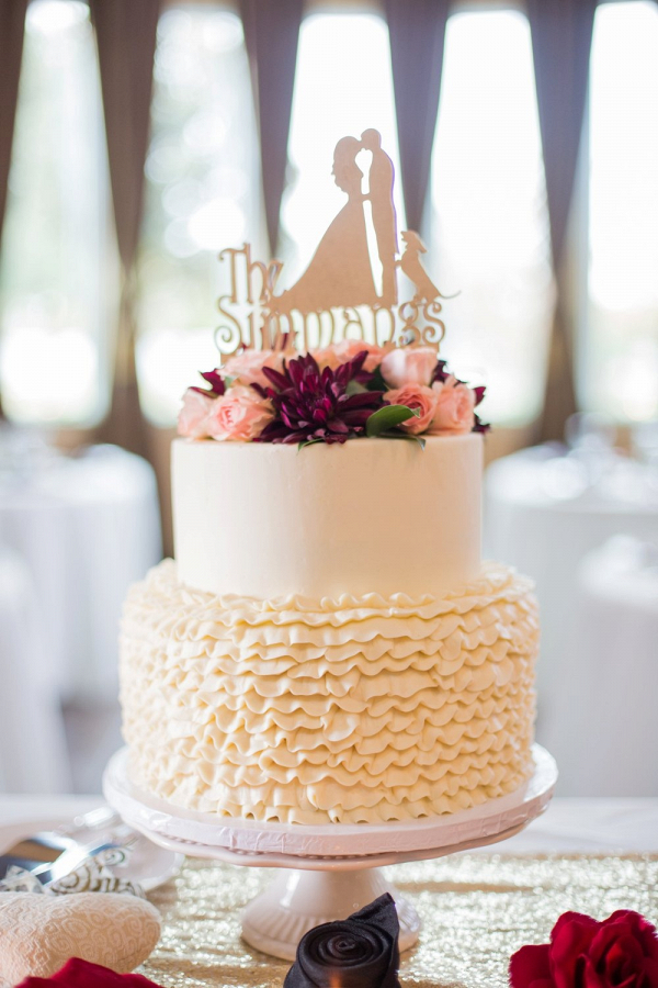 Ruffle wedding cake with silhouette cake topper