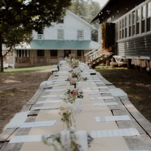 Outdoor wedding reception with long tables and DIY centerpieces