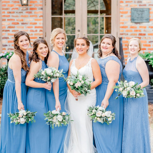 Bridesmaids in long blue dresses
