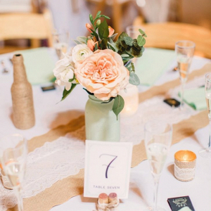 Rustic centerpieces with burlap and lace runners