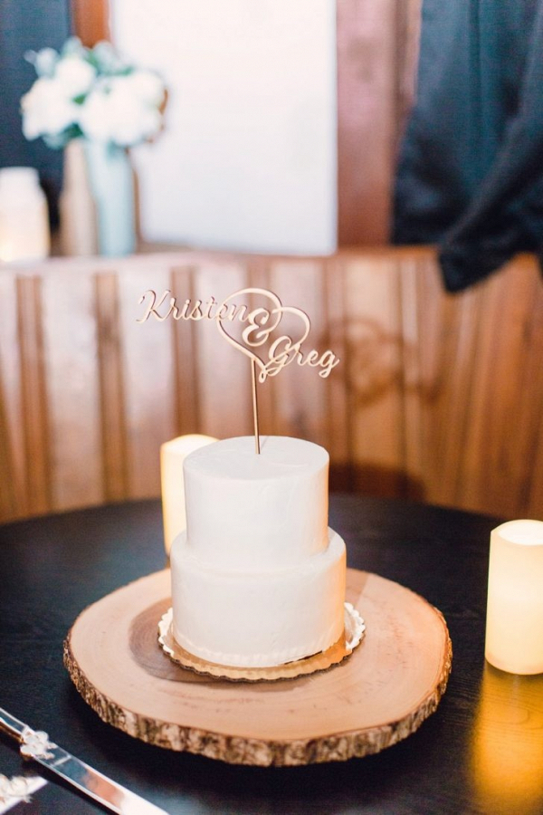 Rustic wedding cake with laser cut topper