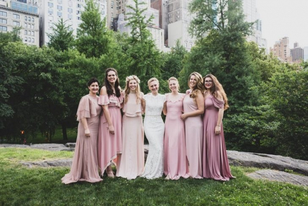 Bridesmaids in long mismatched pink dresses