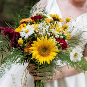 Rustic yellow and red bridal bouquet