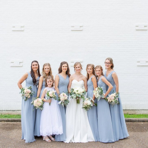 Bridesmaids in long blue gray dresses