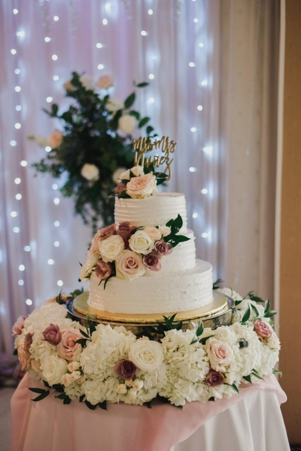Classic white wedding cake with fresh florals