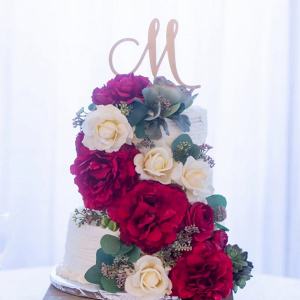 Wedding cake covered in fake flowers