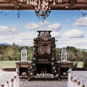 Rustic wedding ceremony with fireplace altar