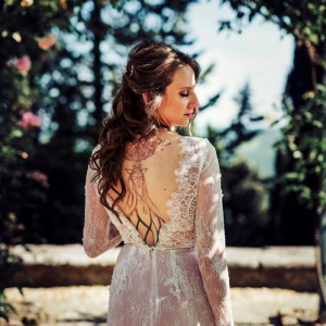 Bride in open back scallop lace wedding dress
