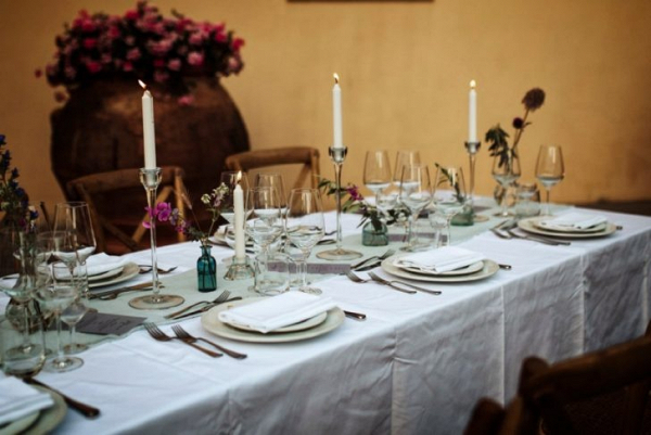 Tuscan wedding table with bud vase centerpieces