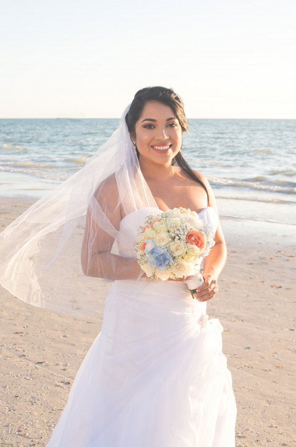 Bride on beach on The Budget Savvy Bride