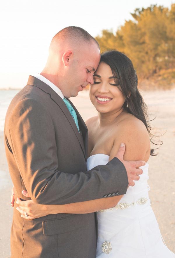 Beach couple portrait on The Budget Savvy Bride