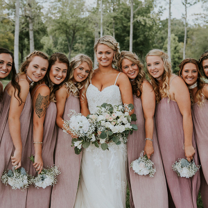 Blush Bridesmaid Dresses with Baby's Breath Bouquets
