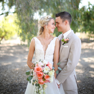 Bride + Groom Portrait with Vibrant Salmon + White Bouquet