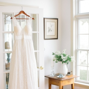 Wedding gown by Celia Grace, florals by Bespoke, Ashley Largesse Photography