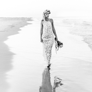 Black and white portrait of beach bride