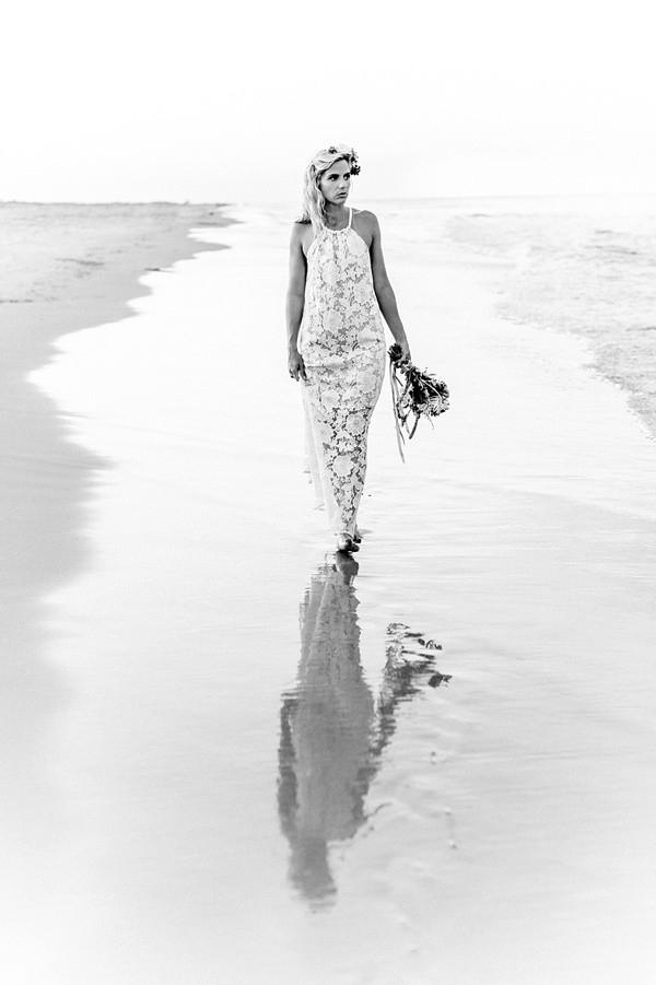 Black and white portrait of beach bride
