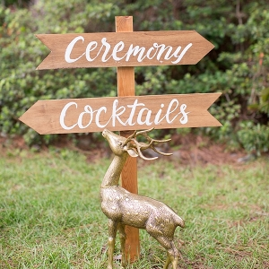 Gold deer with wooden wedding sign