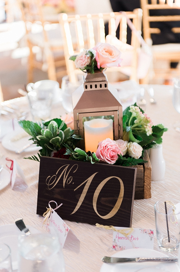Gold lantern and wooden box centerpiece