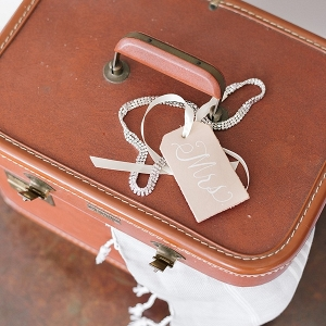 Calligraphy luggage tag on honeymoon suitcase
