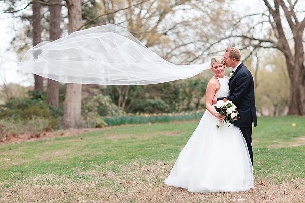 Bride and groom with flowing cathedral veil