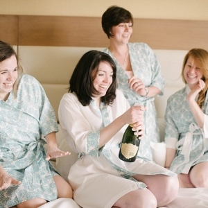 Bridesmaids getting ready with champagne