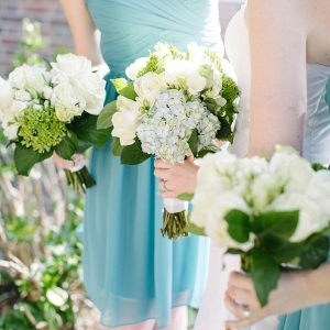 Teal bridesmaid dresses and hydrangea bouquets
