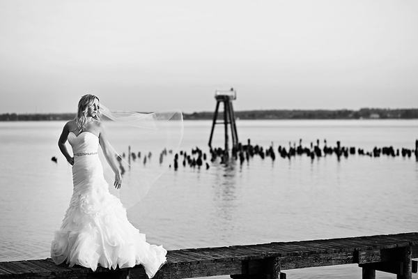Coastal bridal session bride standing on the dock