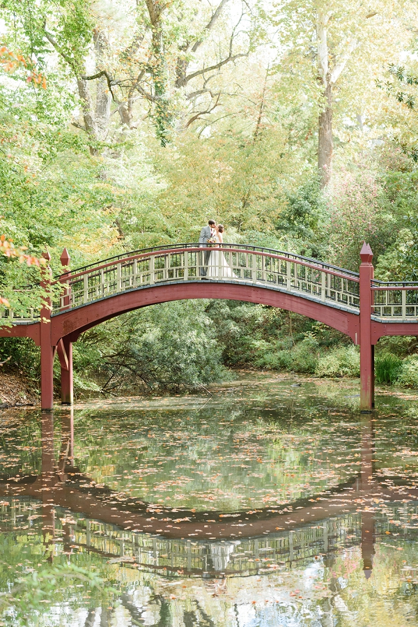 Bride and Groom on Crem Dell Bridge in Williamsburg Virginia
