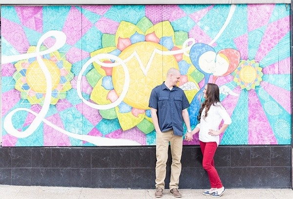 Couple in front of colorful mural