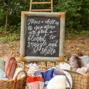 Blanket station for a fall wedding
