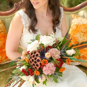 Fall boho wedding bouquet with feathers