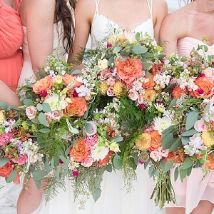 Coral colored wedding bouquets